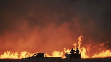 Farmers battle a fire near Cassilis in the central west of New South Wales.