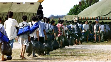 Asylum seekers arrive at Nauru: The offshore processing centre has been fraught with problems since its opening.