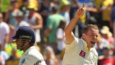 Australian fast bowler Peter Siddle rushes forward after taking the wicket of the great Sachin Tendulkar.
