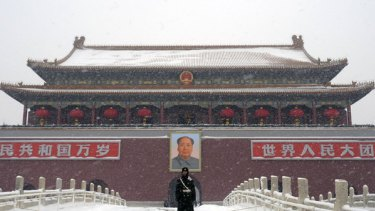 Storms have left the Tiananmen Gate and Beijing covered in snow.