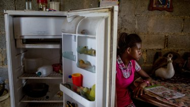 Andrea Sira, 11, at her home on the outskirts of Barlovento. The only food in her fridge was water and mangos.