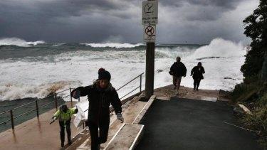 Visitors flee waves at Dee Why