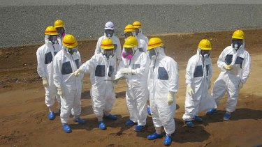 Japan's nuclear regulator orders TEPCO, the operator of the crippled Fukushima power plant to draft in additional workers if needed to plug leaks of radioactive water from its tanks.