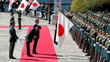 Japanese Prime Minister Shinzo Abe and Prime Minister Tony Abbott during the Welcome Ceremony at the State Guest House in Tokyo.