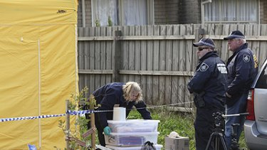 Police officers and forensic experts at a house in the suburb of Glenroy in Melbourne yesterday.