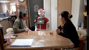 Pepper chats to Rieko and Hirofumi in their kitchen.