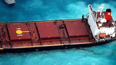 The Chinese coal ship Shen Neng 1 lies stranded and leaking oil on Douglas Shoals in the Great Barrier Reef after running aground on Saturday.