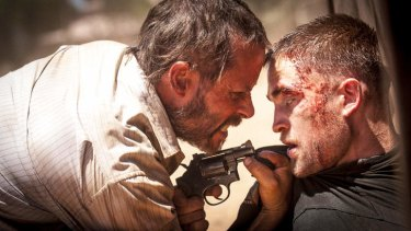 Eric and Rey share a moment ... Guy Pearce and Robert Pattinson in <i>The Rover</i>