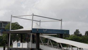 Flood waters tear at the Regatta CityCat terminal.
