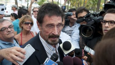 Man of mystery … antivirus software creator John McAfee talks to media in Miami.
