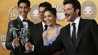 Taste of Hollywood ... Actor Anil Kapoor, far right, with his <i>Slumdog Millionaire</i> cast.