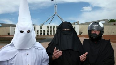 Protesting the burqa: Three men who covered their faces outside Parliament House.