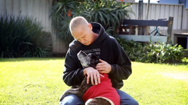 Paul Lawrence with his 15-year-old staffy Ellie who he claims has benefited from a daily dose of cannabis oil.
