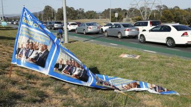 A Liberal Party election banner that had fallen over along Gungahlin Drive in Mitchell.