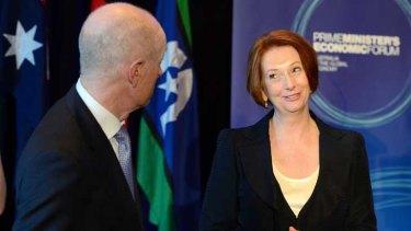 Tete-a-tete: Julia Gillard speaks with Reserve Bank governor Glenn Stevens at the economic forum in Brisbane yesterday.