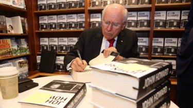 Former prime minister John Howard signs copies of his 2014 book <i>The Menzies Era</i>.