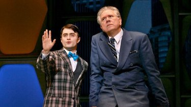 Daniel Radcliffe and John Laroquette share the stage in <i>How To Succeed in Business Without Really Trying</i>.