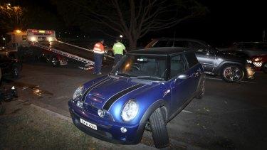 A damaged car at the scene.