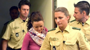 Beate Zschaepe, centre, enters court in Munich, Germany, as part of the trial linked to the far-right National Socialist Underground terror cell.