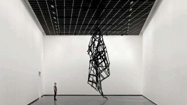 <i>Facade</i>, a crumpled metal sculpture, portrays the failure of the curtain wall.