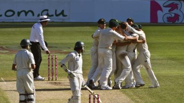 Under question ... the Australians celebrate their unexpected win over Pakistan in the New Year Test.     Majeed allegedly claims to have fixed the result.