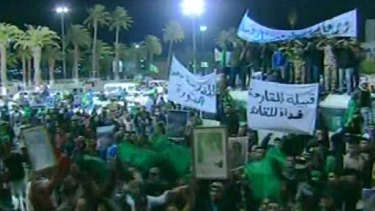 An image grab taken off Libya's state television station shows what the channel said were supporters of Libyan leader Muammar Gaddafi