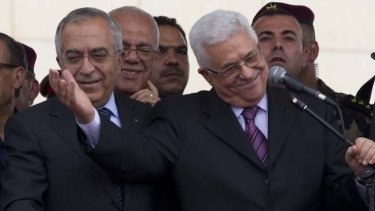 Good to be back ... Mahmoud Abbas, right, and the Palestinian Prime Minister, Salam Fayyad, during a ceremony held to welcome Mr Abbas's return.