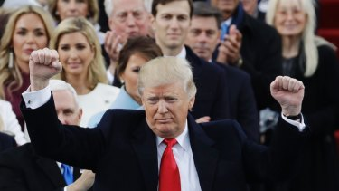 President Donald Trump pumps his fist after delivering his inaugural address.