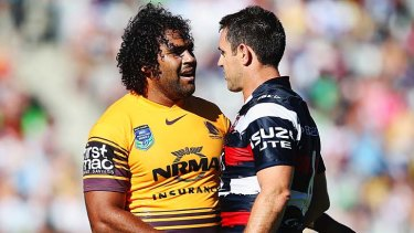 Congratulations: Sam Thaiday of the Broncos shakes hands with Brad Fittler of the Roosters.