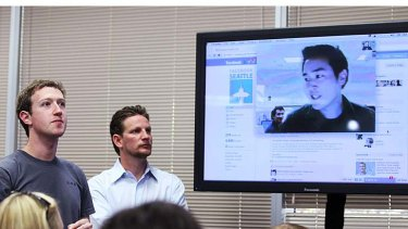 Facebook CEO Mark Zuckerberg, left, watches a demonstration of the new Facebook video chat during a news conference at Facebook headquarters.