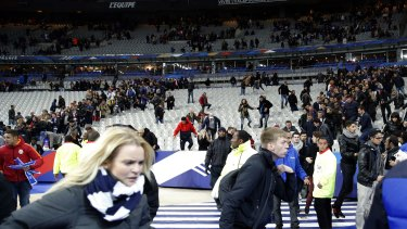Spectators flee the Stade de France stadium after the international friendly soccer match between France and Germany.