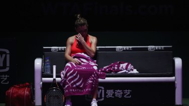 Simona Halep looks dejected after going down to Angelique Kerber.