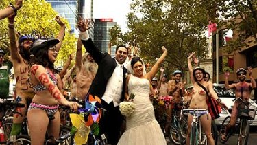 Members of Melbourne's World Naked Bike Ride give newlyweds Laura and Angelo Puopolo a rousing reception in the city yesterday.