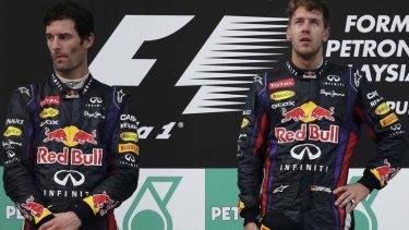 Angry: Mark Webber stands next to Sebastian Vettel on the podium.