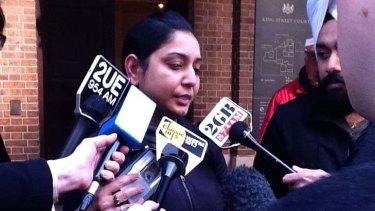 Not satisfied ... Jaspreet Kaur, the sister of homicide victim Manpreet Kaur, faces the media.