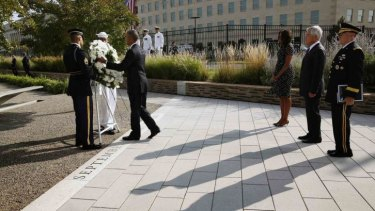 President Obama lays a wreath at the National 9/11 Pentagon Memorial.