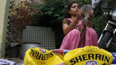 18-year-old Ruby has been stitching full-time since she was pulled out of school at 14. She stitches six days a week, for between six an eight hours a day. To stitch a Sherrin Auskick ball takes an hour, and she is paid seven Rupees, about 12c, for every completed ball.