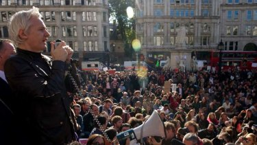 Julian Assange addresses demonstrators from the steps of St Paul's Cathedral in central London.