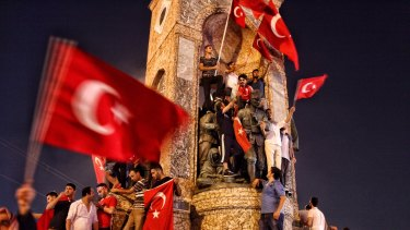 Supporters of Turkish President Recep Tayyip Erdogan wave flags after a military coup was foiled.