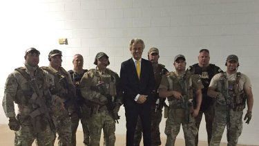 Dutch politician Geert Wilders with some of the police who responded to the attack.