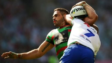 Going backwards: Souths star Greg Inglis is driven back by Terry Campese in the loss to the Raiders.