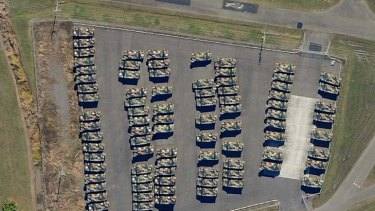An aerial picture taken last month shows 89 Bushmasters, worth more than $90 million, in storage near Brisbane Airport.