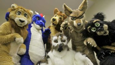"""Hirstute: Like-minded individuals dressed as lions, dragons and other animals gather in Melbourne for the annual """"furries"""" convention."""