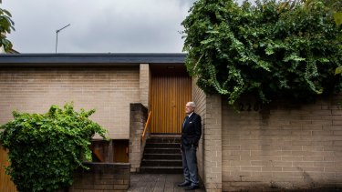 Architect Neil Clerehan at the Domain Rd house he designed in South Yarra that has been heritage listed.