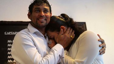 Tillakaratne Dilshan comforts his wife, Manjula Thilini, after she broke down when he announced his retirement from Test cricket in Colombo.