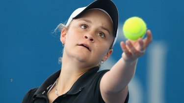Ashleigh Barty of Australia serves in her doubles match partnered with Casey Dellacqua at the 2014 Brisbane International.