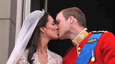 Their Royal Highnesses Prince William, Duke of Cambridge and Catherine, Duchess of Cambridge kiss on the balcony at Buckingham Palace.