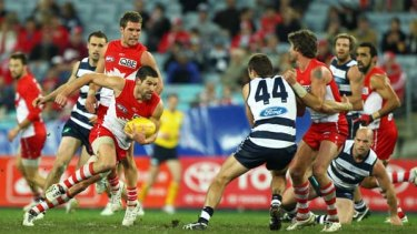 Heavy traffic ...  Sydney's Martin Mattner tries to weave his way past Geelong's defenders during the heavy loss to the  reigning premiers at ANZ Stadium last night.