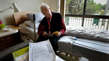 Jia Qi Niu in his room at the Elderly Chinese Home.