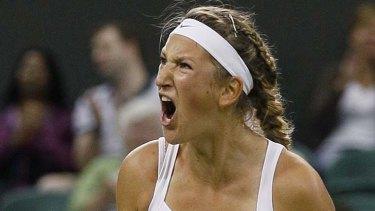 Defending her grunting ... Victoria Azarenka of Belarus celebrates her win over Austria's Tamira Paszek.